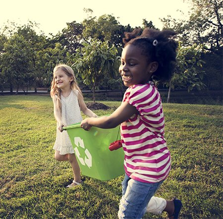 Girls playing with recycling bin