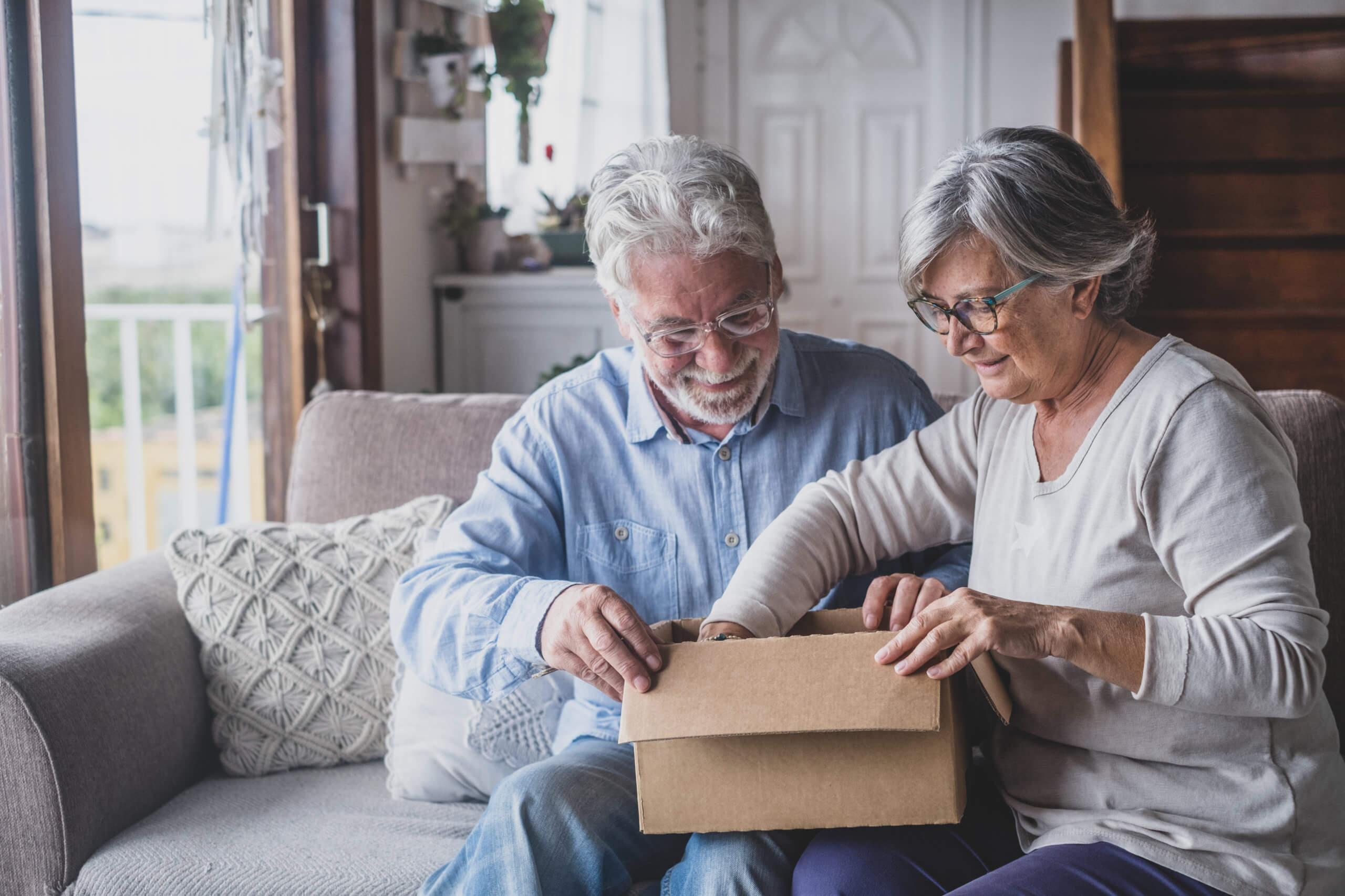 An old couple opens a box